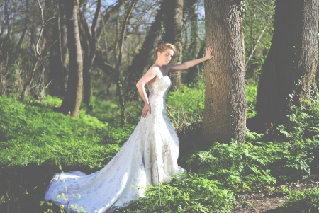 beautiful girl bride in green wood by summer