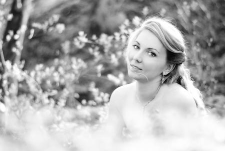 beautiful girl in wood amongst green sheet  Stock Photo