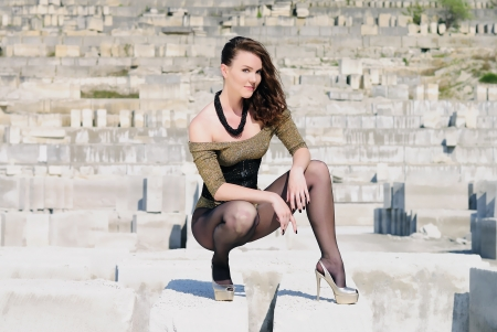 beautiful girl on heel amongst stone captive  photo
