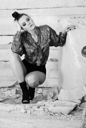 cogitation: bright girl on heel amongst stone captive  Stock Photo