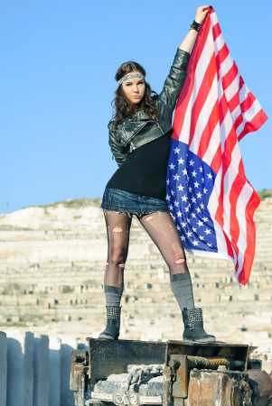 bright girl amongst stone captive with american flag  photo