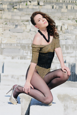 beautiful girl on heel amongst stone captive