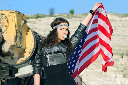 cogitation: bright girl amongst stone captive with american flag