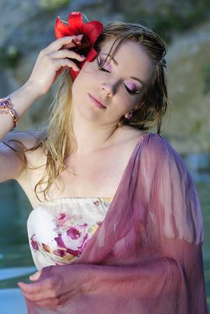 gentile: beautiful girl blonde in water red flower