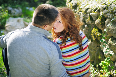 Young beautiful couple in park