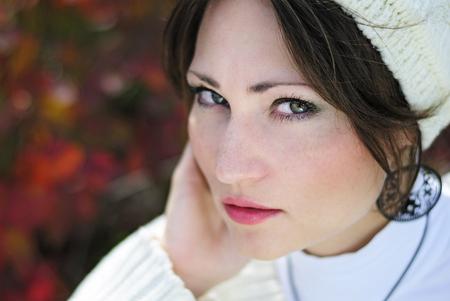 portrait of a beautiful girl in a cap fall