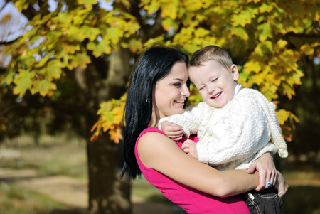 little boy with his mother in autumn park Stock Photo