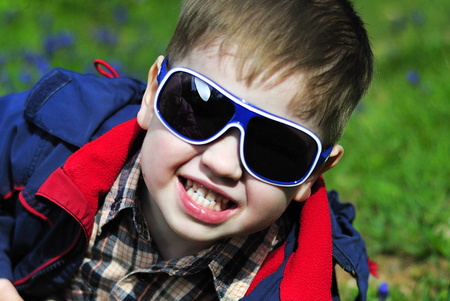 smiling little boy with glasses Stock Photo