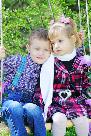 couple in love little children on green meadow