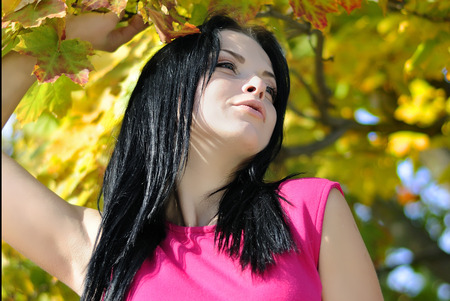 beautiful girl in a business suit in the autumn park