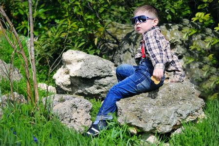 little boy on the green grass Stock Photo