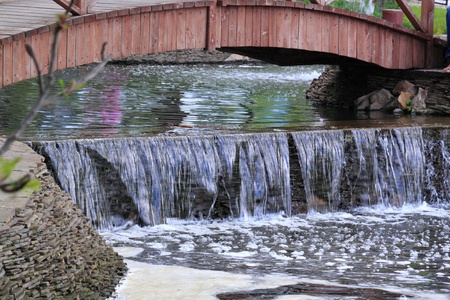 A water cascade is in the city park of rest Stock Photo