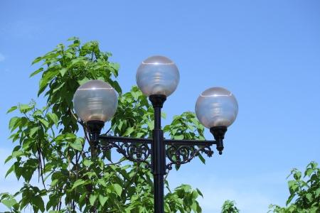 Decorative lantern of nightly illumination in a park on a background blue sky