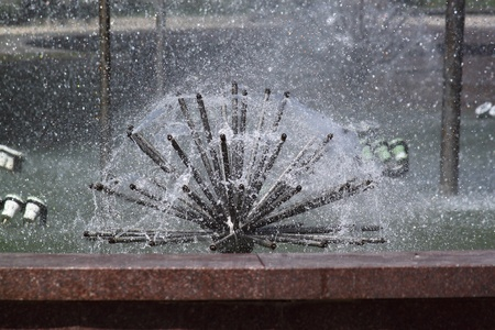 A fountain is in a city park