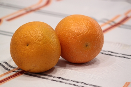 Orange fruit on the table on a white background