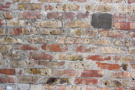 Age-old brick wall Stock Photo