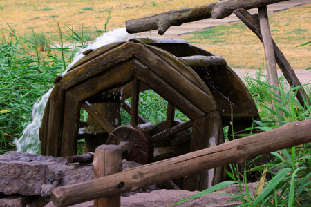 Water-mill at a lake in a park