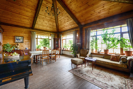 Russia, Moscow - the interior living room wooden country house.