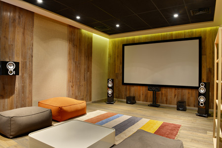 The interior of the home theater in a modern luxury home.