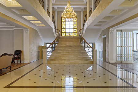 Design of stairs in a rich house. Russia, Moscow region - interior design in luxury house.