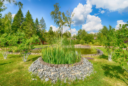 Russia, landscape design and construction of the pond at the country house Stock Photo