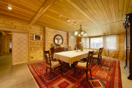 Interior of the living room in a wooden country house.