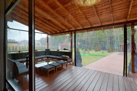 Stylish gazebo with garden furniture. Stock Photo