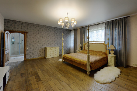 Stylish bedroom with double bed.