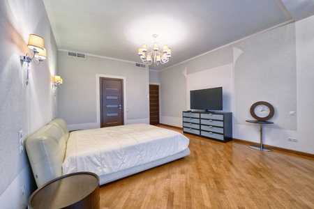 Modern interior of a bedroom in the new house. Stock Photo