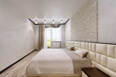 Modern interior of a bedroom in the new house. Standard-Bild