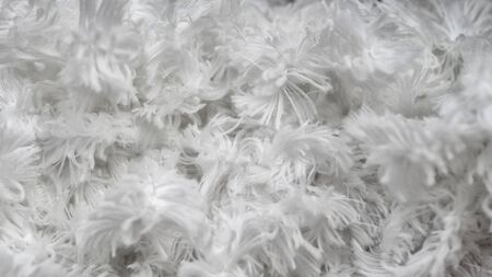 White shaggy faux long fur close up, background