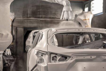 Production line of automobile plant, paint shop. Car body after applying the base paint. Stock fotó