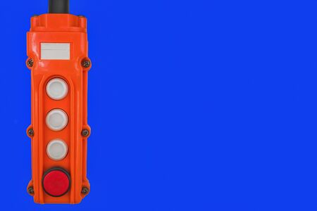 Orange control panel with four buttons on a blue isolated background