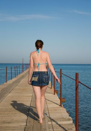 svelte: svelte woman is walking on pier