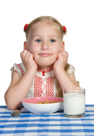 little girl with her breakfast over white photo