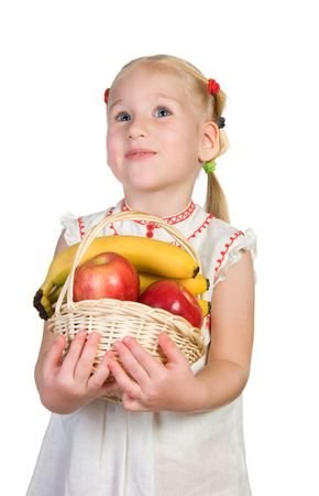 little woman is carrying basket with harvest photo