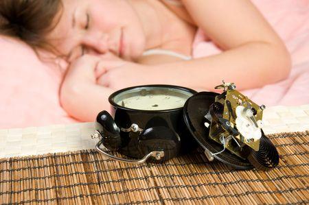 broken alarm-clock is result of unsuccessful awakening (focus on clock) photo