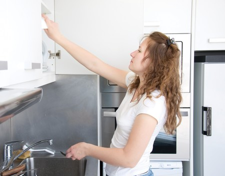 young attractive woman is washing dishes photo