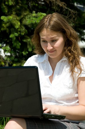 dinnertime: adorable astonished woman with laptop outdoor