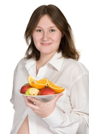 portrait of attractive pregnant woman with fruits over white Stock Photo - 9071619