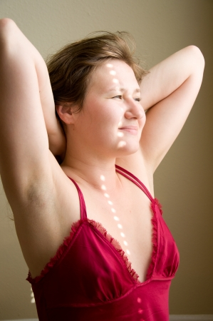 attractive woman is stretching herself in the morning photo