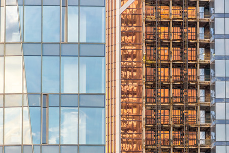 housebuilding: Background with windows of modern business building