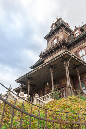 woodland  horror: Paris, France - September 13, 2015: Facade of the Ghost House attraction in the Paris Disneyland