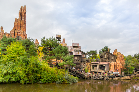 Paris, France - September 13, 2015: View on the attraction Big Thunder Mountain in the Paris Disneyland with people in trolleys. Editorial
