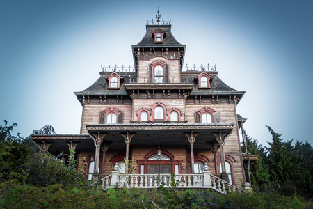 woodland  horror: Paris, France - September 14, 2015: Front view on facade of the Ghost House attraction in the Paris Disneyland Editorial