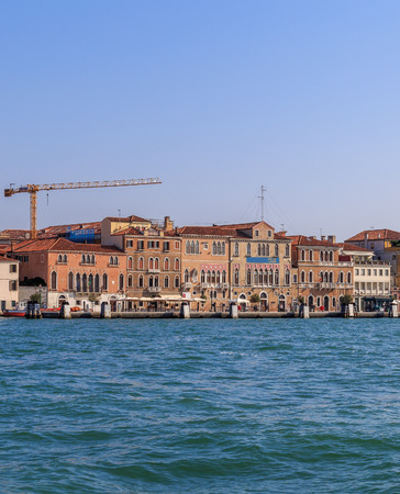fasade: Colorful weathered facades of old venetian buildings, vertical shot Stock Photo