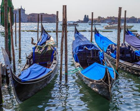 Gondolas at the wharf Venice, summer day