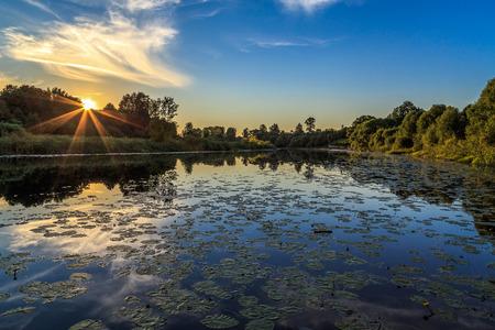 Sunset over the river, evening hot day, gorizontal shot Stock Photo