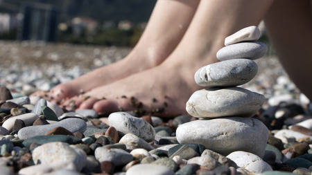 A young woman on beach with stones photo
