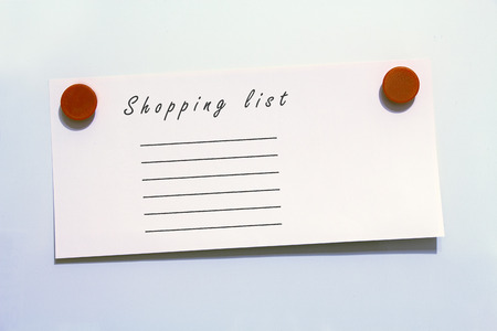 magnetic clip: Shopping list with magnets, white background
